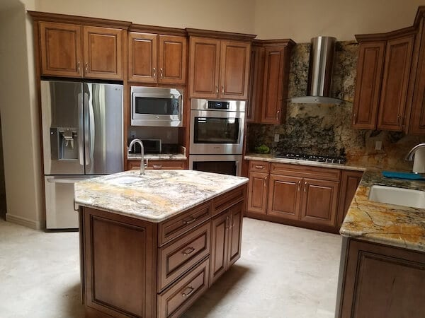 Kitchen cabinets stained with dark finish