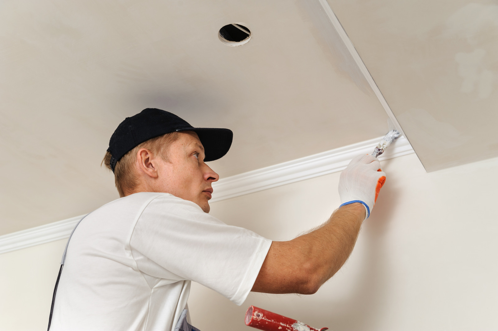 Painter is painting walls and ceilings